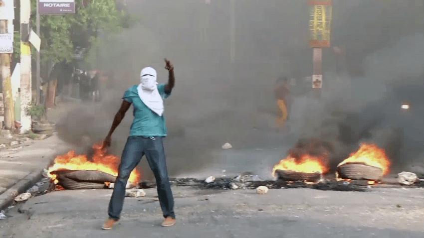 070718 Haiti Protest Fire