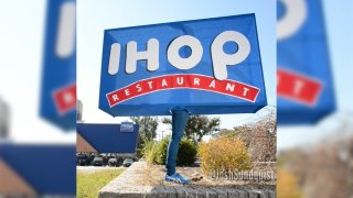 """A blue sign with the letters """"IHOP"""" in white"""