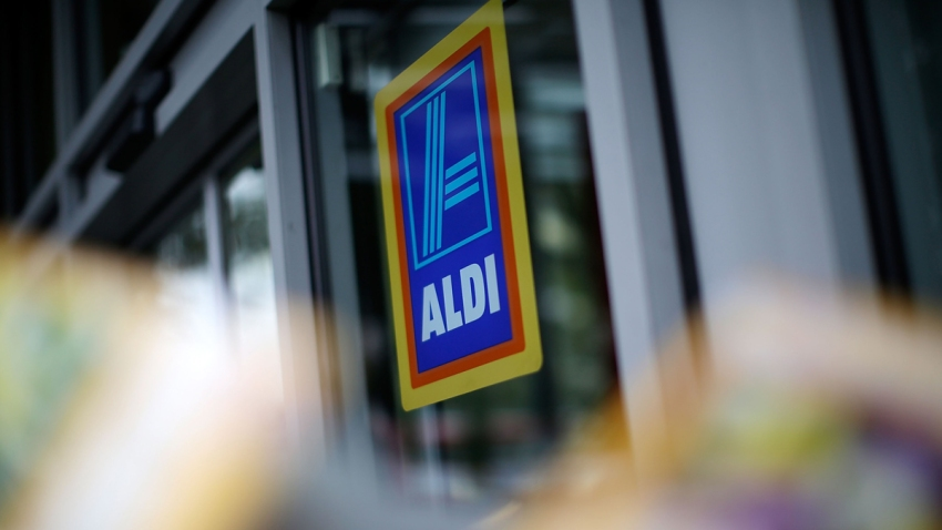 In this Sept. 29, 2014, file photo, logos adorn an Aldi supermarket on Old Kent Road in London, England.