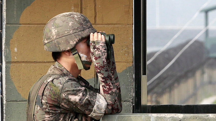 In this July 13, 2014, file photo, a South Korean army soldier looks through a pair of binoculars at a military check point at the Imjingak Pavilion near the border with North Korea.