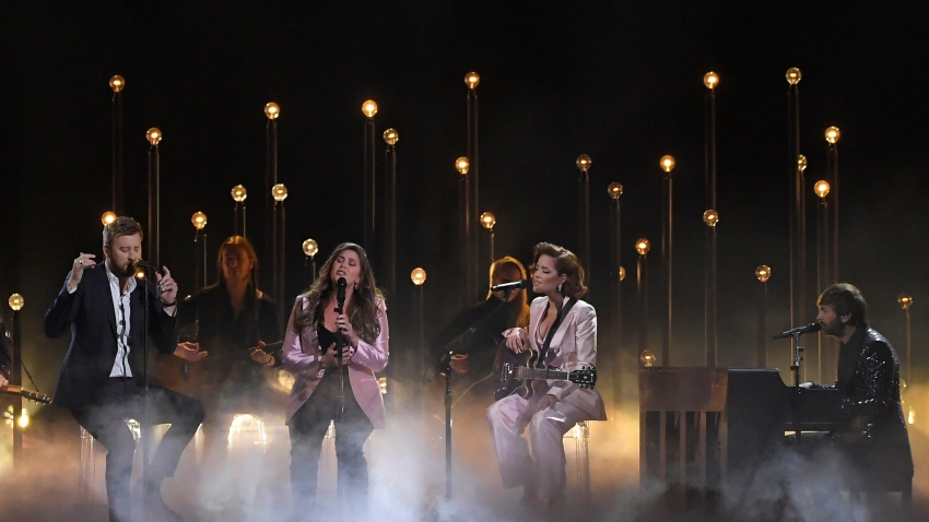 """Charles Kelley, left, Hillary Scott, second left and Dave Haywood, right, of Lady Antebellum perform """"What if I Never Get Over You"""" and """"Graveyard"""" with Halsey, second from right at the 53rd annual CMA Awards at Bridgestone Arena, Wednesday, Nov. 13, 2019, in Nashville, Tenn."""