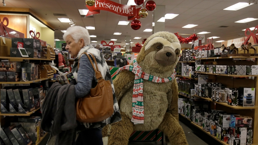 Customers shop at a Kohl's store in Colma, Calif., Friday, Nov. 29, 2019. Black Friday once again kicked off the start of the holiday shopping season.