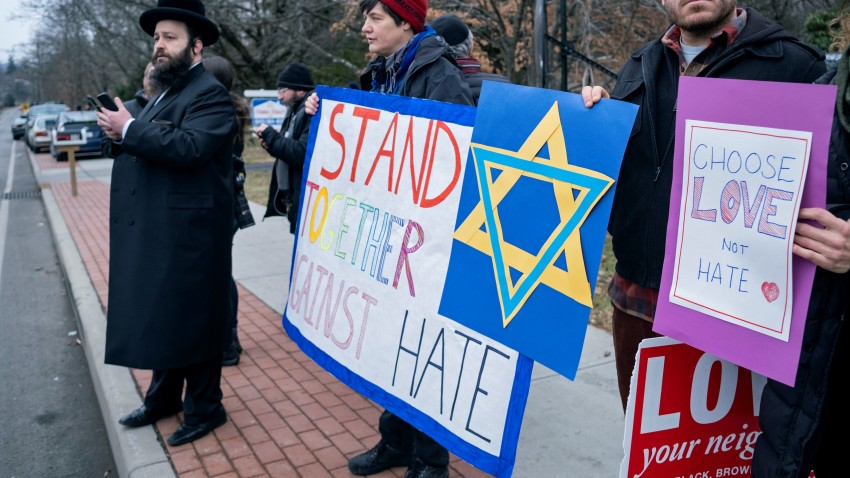 In this Dec. 29, 2019, file photo, neighbors gather to show their support of the community near a rabbi's residence in Monsey, New York.