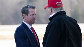 Gov. Brian Kemp, R-Ga., greets President Donald Trump as he steps off Air Force One during arrival, Friday, March 6, 2020, at Dobbins Air Reserve Base in Marietta, Ga.
