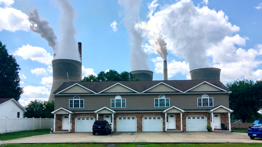 FILE - In this Aug. 23, 2018, file photo, a coal-fired plant in Winfield, W.Va, is seen from an apartment complex in the town of Poca across the Kanawha River.