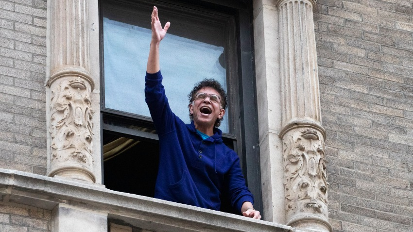 Brian Stokes Mitchell sings from his window