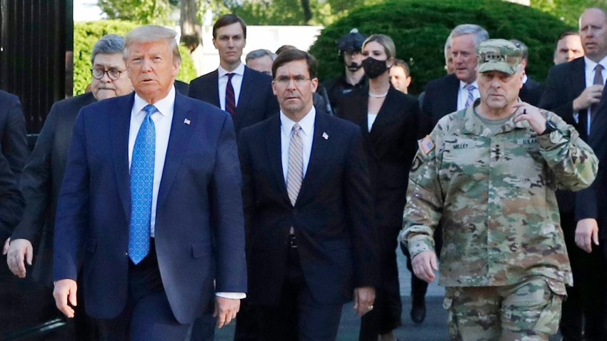 In this June 1, 2020 file photo, President Donald Trump departs the White House to visit outside St. John's Church, in Washington. Part of the church was set on fire during protests on Sunday night. Walking behind Trump from left are, Attorney General William Barr, Secretary of Defense Mark Esper and Gen. Mark Milley, chairman of the Joint Chiefs of Staff.