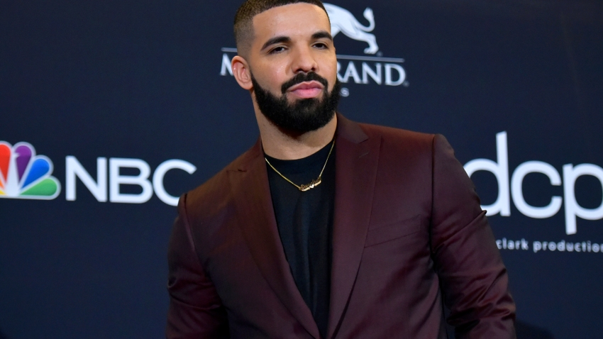 """FILE - This May 1, 2019 file photo shows Drake at the Billboard Music Awards in Las Vegas. Drake is the leading nominee at the 2020 BET Awards, which will celebrate its 20th anniversary later this month. BET announced Monday that Drake is nominated for six honors, including video of the year and best male hip-hop artist. For both best collaboration and the viewer's choice award, Drake is nominated twice thanks to the hits """"No Guidance"""" with Chris Brown and """"Life Is Good"""" with Future."""