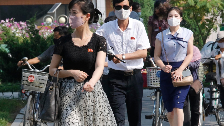 "People wearing masks walk in the Ryomyong street in Pyongyang, North Korea Friday, July 3, 2020. North Korean leader Kim Jong Un urged officials to maintain alertness against the coronavirus, warning that complacency risked ""unimaginable and irretrievable crisis,"" state media said Friday."