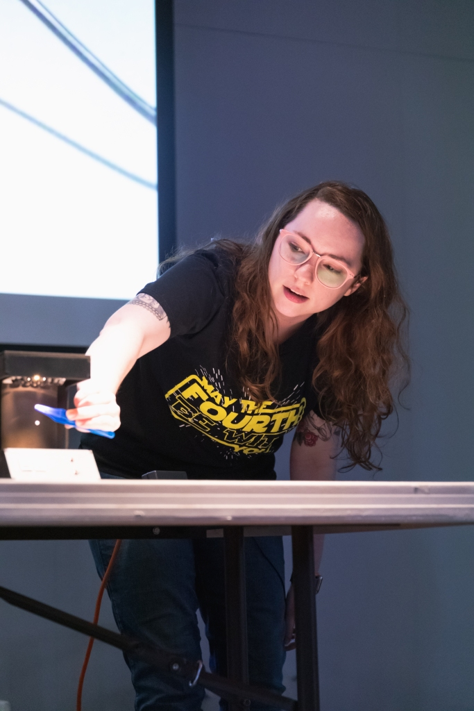 woman performs demonstration at perot museum