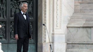Italian tenor and opera singer Andrea Bocelli sings on a deserted Piazza del Duomo in central Milan on April 12, 2020.