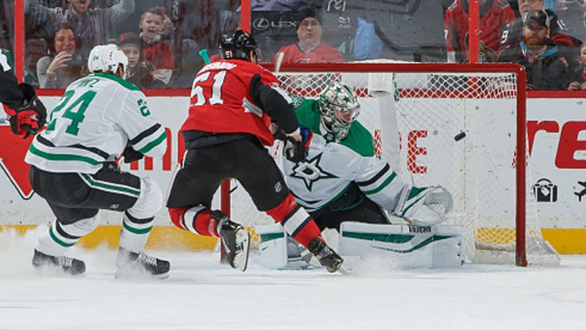 Artem Anisimov #51 of the Ottawa Senators scores the overtime winning goal against Anton Khudobin #35 and Roope Hintz #24 of the Dallas Stars at Canadian Tire Centre on Feb. 16, 2020 in Ottawa, Ontario, Canada.