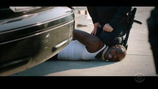 """In this video grab issued Sunday, June 28, 2020, by BET, rapper DaBaby performs """"Rockstar"""" as an actor playing a police officer presses his knee on DaBaby's neck, replicating the last few moments of George Floyd's life, during the BET Awards."""