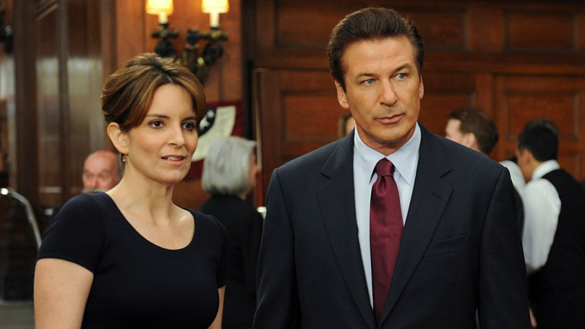 """This image released by NBC shows Tina Fey, left, and Alec Baldwin in """"30 Rock."""""""