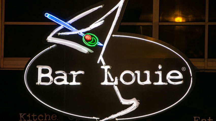 """The entrance to Bar Louie is viewed on March 26, 2013, in Chicago, Illinois. Visitors to """"The Windy City,"""" the third most populous city in the United States, have had to bundle up due to an unusually cold spring."""