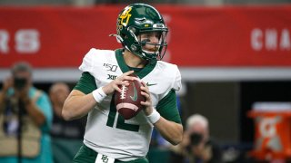 Charlie Brewer #12 of the Baylor Bears looks to throw against the Oklahoma Sooners in the first half of the Big 12 Football Championship at AT&T Stadium on Dec. 7, 2019 in Arlington, Texas.