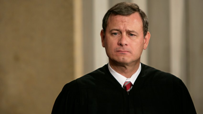 In this undated file photo, Chief Justice John Roberts attends the ceremonial swearing-in of new Attorney General Michael Mukasey at the Justice Department in Washington DC.