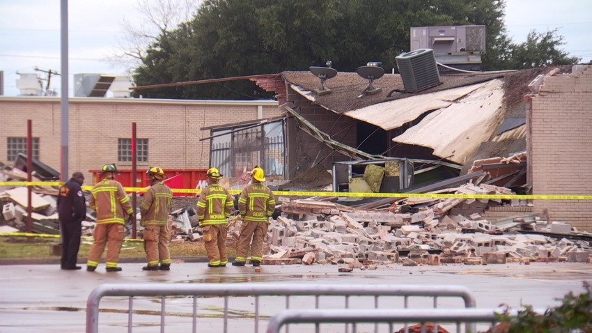 A building collapsed in the 7100 block of John W. Carpenter Freeway in Dallas, Texas on Saturday, Dec. 28, 2019.
