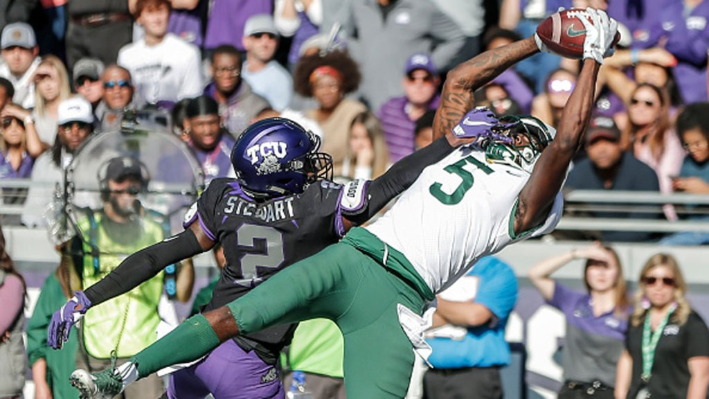Baylor Bears wide receiver Denzel Mims (5) catches a touchdown pass over TCU Horned Frogs cornerback Kee'yon Stewart (2) in overtime during the game between the TCU Horned Frogs and the Baylor Bears on November 09, 2019 at Amon G. Carter Stadium in Fort Worth, Texas.