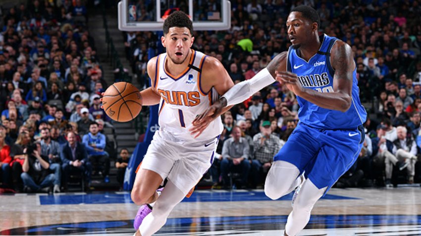 Devin Booker #1 of the Phoenix Suns drives to the basket against the Dallas Mavericks on Jan. 28, 2020 at the American Airlines Center in Dallas, Texas.