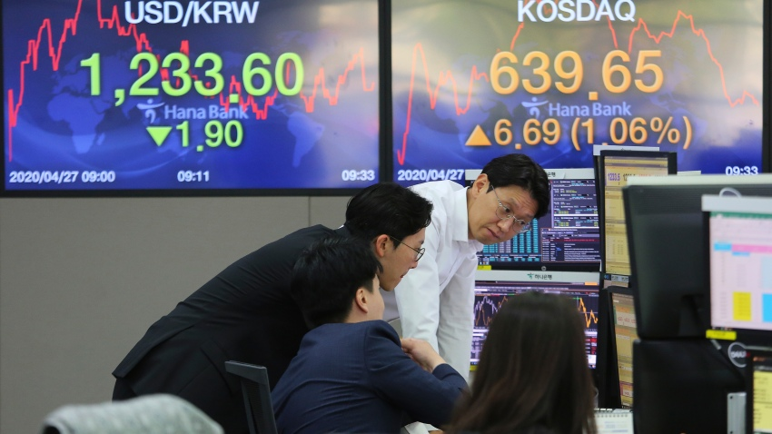In this April 27, 200, file photo, currency traders watch monitors at the foreign exchange dealing room of the KEB Hana Bank headquarters in Seoul, South Korea.