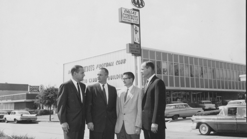A photo of the Cowboys initial leadership group, pictured in front of the team's first administrative offices on North Central Expressway.