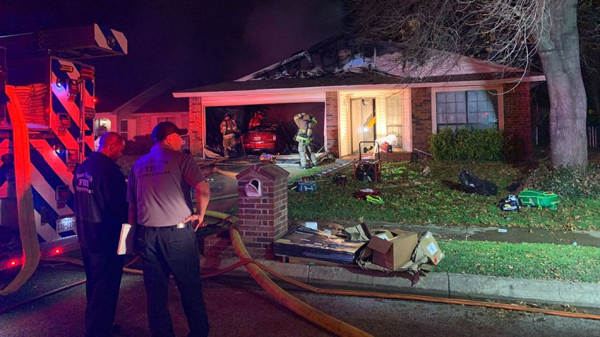 A woman rescued from a house fire in Fort Worth Monday evening was rushed to the hospital with critical burn injuries, firefighters said.