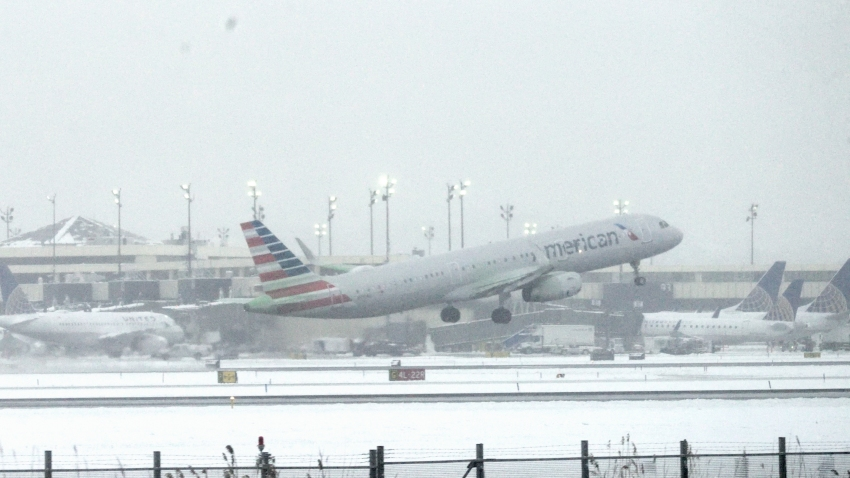 An American Airlines plane takes off from Newark International Airport