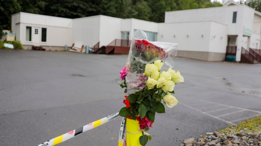 Flowers and police cordon are pictured in front of the Al-Noor Islamic Centre Mosque in Baerum near Oslo, Norway on August 12, 2019.