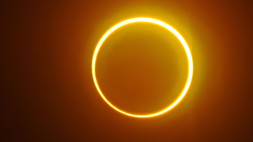 "The moon moves in front of the sun in a rare ""ring of fire"" solar eclipse"