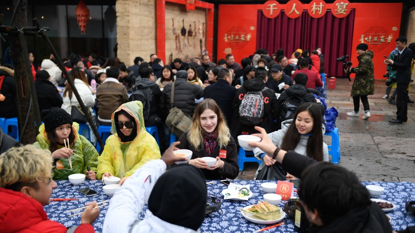 overseas students attend a long-table feast marking the upcoming Chinese Lunar New Year