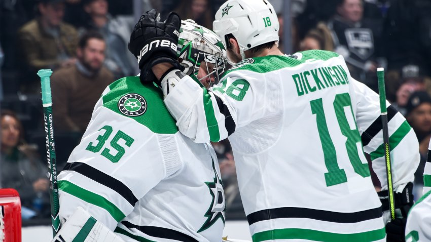 Anton Khudobin #35 of the Dallas Stars and Jason Dickinson #18 celebrate their win during the third period against the Los Angeles Kings at STAPLES Center on January 8, 2019 in Los Angeles, California.