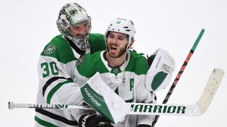 Dallas Stars goalie Ben Bishop (30) puts his arms around center Tyler Seguin (91) after the Stars defeated the Anaheim Ducks 3 to 0 in a game played on January 9, 2020 at the Honda Center in Anaheim, CA.