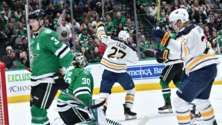 Curtis Lazar #27 and the Buffalo Sabres celebrate a goal against the Dallas Stars at the American Airlines Center on January 16, 2019 in Dallas, Texas.