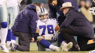 Xavier Su'a-Filo #76 of the Dallas Cowboys reacts after suffering an injury during the second half against the Philadelphia Eagles.