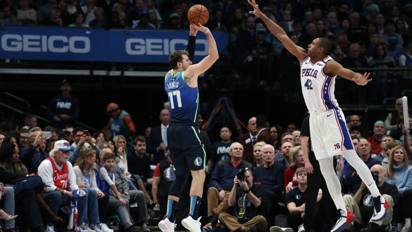 Luka Doncic #77 of the Dallas Mavericks takes a shot against Al Horford #42 of the Philadelphia 76ers at American Airlines Center on January 11, 2020 in Dallas.