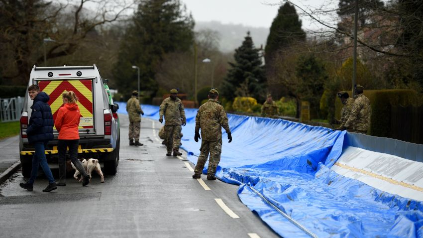 Members of the 4th Battalion Royal Regiment of Scotland erect a flood barrier in preparation for Storm Dennis