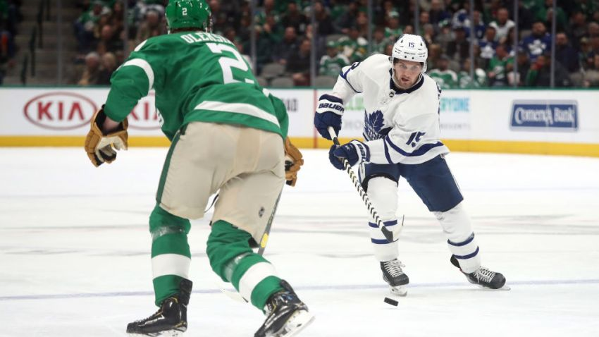 Alexander Kerfoot #15 of the Toronto Maple Leafs skates the puck against the Dallas Stars in the second period at American Airlines Center on January 29, 2020 in Dallas, Texas.