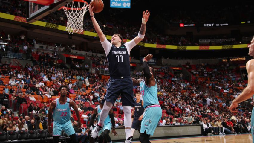 Luka Doncic #77 of the Dallas Mavericks shoots the ball against the Miami Heat on February 28, 2020 at American Airlines Arena in Miami, Florida.