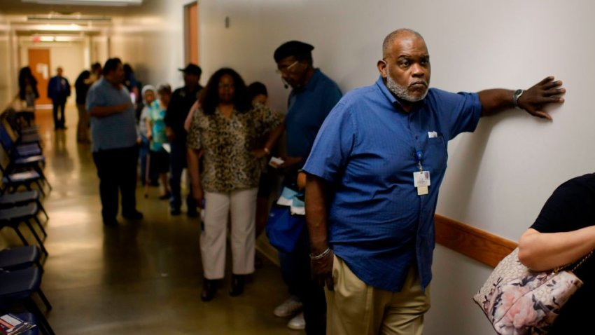 Voters wait in line to cast their ballots during the Democratic presidential primary in Houston, Texas on Super Tuesday, March 3, 2020. - Fourteen states and American Samoa are holding presidential primary elections, with over 1400 delegates at stake. Americans vote Tuesday in primaries that play a major role in who will challenge Donald Trump for the presidency, a day after key endorsements dramatically boosted Joe Biden's hopes against surging leftist Bernie Sanders. The backing of Biden by three of his ex-rivals marked an unprecedented turn in a fractured, often bitter campaign.