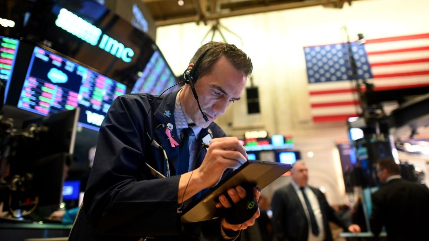 In this file photo, a trader works during the closing bell at the New York Stock Exchange on March 3, 2020, on Wall Street in New York City.