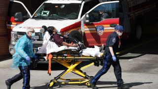 EMTs bring a patient into Wyckoff Hospital in Brooklyn on April 6, 2020.