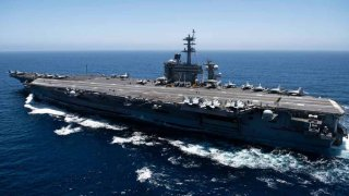 In this handout released by the U.S. Navy, The aircraft carrier USS Theodore Roosevelt (CVN 71) transits the Pacific Ocean.