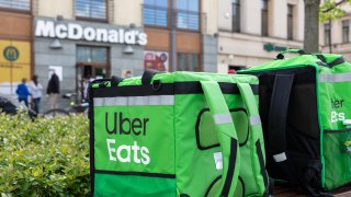Uber Eats delivery bags wait in front of a McDonald's in Lublin, Poland on May3, 2020.
