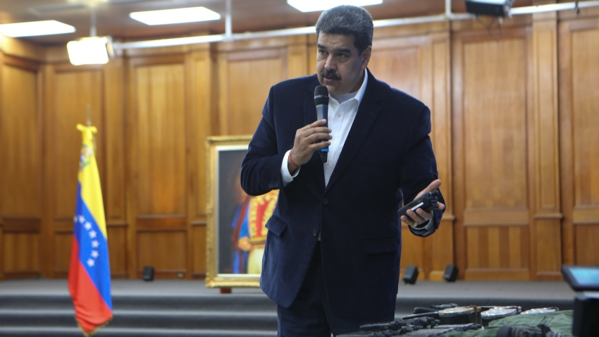 "Venezuelan President, Nicolas Maduro displays seized armament and passports after a meeting with members of the Armed Forces in Caracas, Venezuela on May 4, 2020. Venezuela's President Nicolas Maduro confirmed the detention of two US ""mercenaries"" among 13 attackers involved in Sunday's two failed maritime raids."