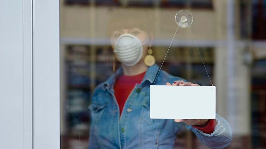 woman in closed shop with mask