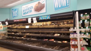 Empty shelves are visible in the meat section, with a sign reading Kosher Meat, at the Best Market supermarket on Long Island, New York during an outbreak of the COVID-19 coronavirus, March 14, 2020.