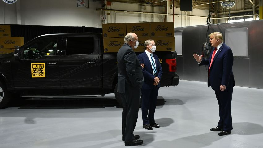 Ford Motor Company CEO Jim Hackett (L) and Executive Chairman of Ford William Clay Ford Jr. (C) speak with US President Donald Trump as they tour the Ford Rawsonville Plant in Ypsilanti, Michigan on May 21, 2020.