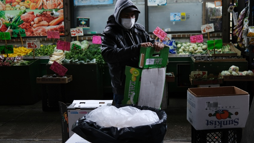A grocery store worker recycles boxes in Brooklyn, March 28, 2020.