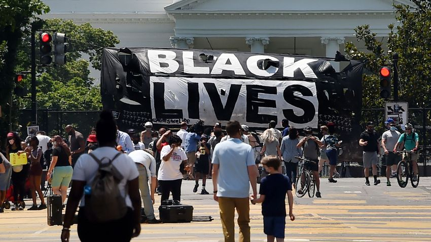 A Black Lives Matter banner hangs on the fence around the White House to protest the death of George Floyd, on June 10, 2020.